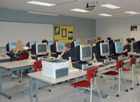 Van Wert High School students work in the new computer lab recently. Students in area schools must sign a release form before utilizing the Internet during the school day.
