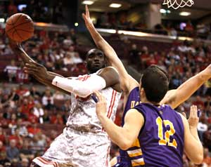 Ohio State's Evan Ravenel, left, works for a rebound against Albany's John Puk (partially obscured) and Peter Hooley (12) during the first half of an NCAA college basketball game in Columbus, Ohio, Sunday, Nov. 11, 2012. (AP Photo/Paul Vernon)