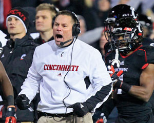 Cincinnati coach Butch Jones cheers on his team after a touchdown in the second half of the team's 27-10 win over South Florida in an NCAA college football game, Friday, Nov. 23, 2012, in Cincinnati. (AP Photo/Al Behrman)