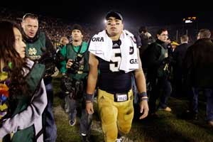 In this Nov. 17, 2012, file photo, Notre Dame linebacker Manti Te'o walks off the field following an NCAA college football game against Wake Forest in South Bend, Ind. A story that Te'o's girlfriend had died of leukemia _ a loss he said inspired him to help lead the Irish to the BCS championship game _ was dismissed by the university Wednesday, Jan. 16, 2013, as a hoax perpetrated against the linebacker. (AP Photo/Michael Conroy, File)