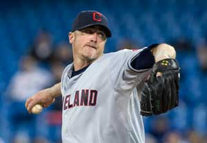 Cleveland Indians starting pitcher Brett Myers works against the Toronto Blue Jays during the first inning of a baseball game in Toronto on Thursday, April 4, 2013. (AP Photo/The Canadian Press, Chris Young)