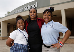 Socar Chatmon-Thomas, center, stands with her daughters Isabella, left, and Guinevere, right, outside their school in Austin, Texas on Monday, April 8, 2013. (AP Photo/Eric Gay)