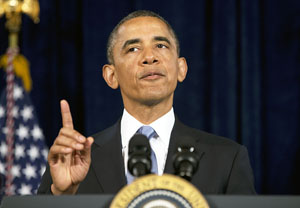In this June 7, 2013 file photo, President Barack Obama gestures as he talks about the Affordable Care Act in San Jose, Calif. (AP Photo/Evan Vucci, File)