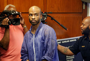 Michael Madison is brought into court for his arraignment in East Cleveland, Ohio on Monday, July 22, 2013. Madison is charged with aggravated murder in the deaths of three women found in garbage bags in the city over the weekend. (AP Photo/Mark Duncan)