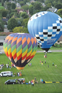 In this 2012 file photo, hot air balloons give rides to special needs residents as part of a preview day for that year's Hot Air Festival. Hot air balloons will fly over Van Wert again this year from September 6-8 as the festival returns. (TB File Photo)