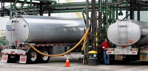 In this April 20, 2011 file photo, an oilman prepares to fill his truck with home heating fuel at a depot in Quincy, Mass. (AP Photo/Charles Krupa)